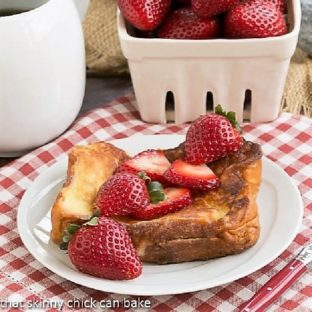 Strawberry Mascarpone Stuffed French Toast on a white plate topped with fresh strawberries featured image