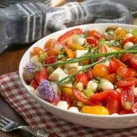 Caprese Salad with Chicken in a white serving bowl