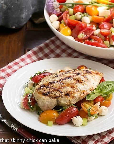 Grilled chicken breast over a Caprese Salad with Chicken