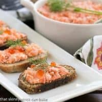 Salmon Rillettes on toasts on a white platter