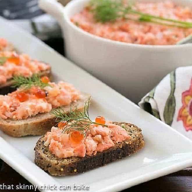 Salmon Rillettes  on toasts on a white platter