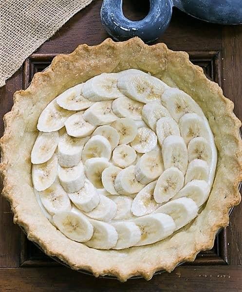 Banana Cream Cheesecake Pie with crust and layer of bananas