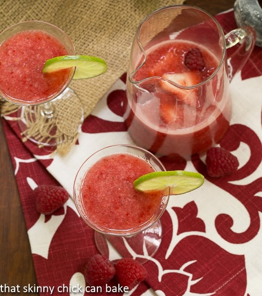 Overhead view Frozen Fresh Berry Daiquiris in glasses and in a pitcher
