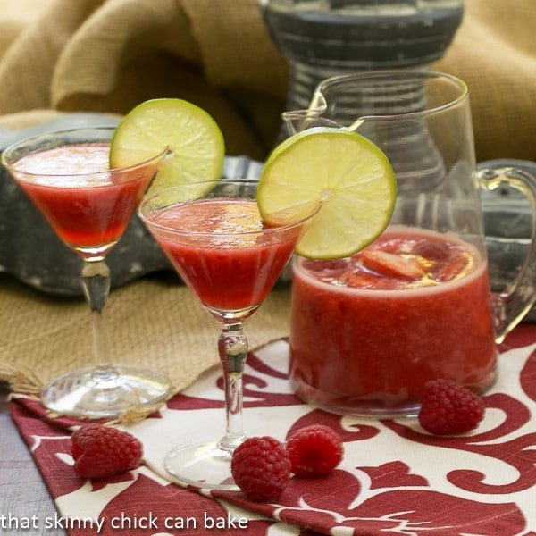 Berry Daiquiris in martini glasses garnished with lime slices