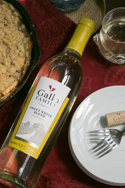 Grilled Apple Crisp with a bottle of white wine