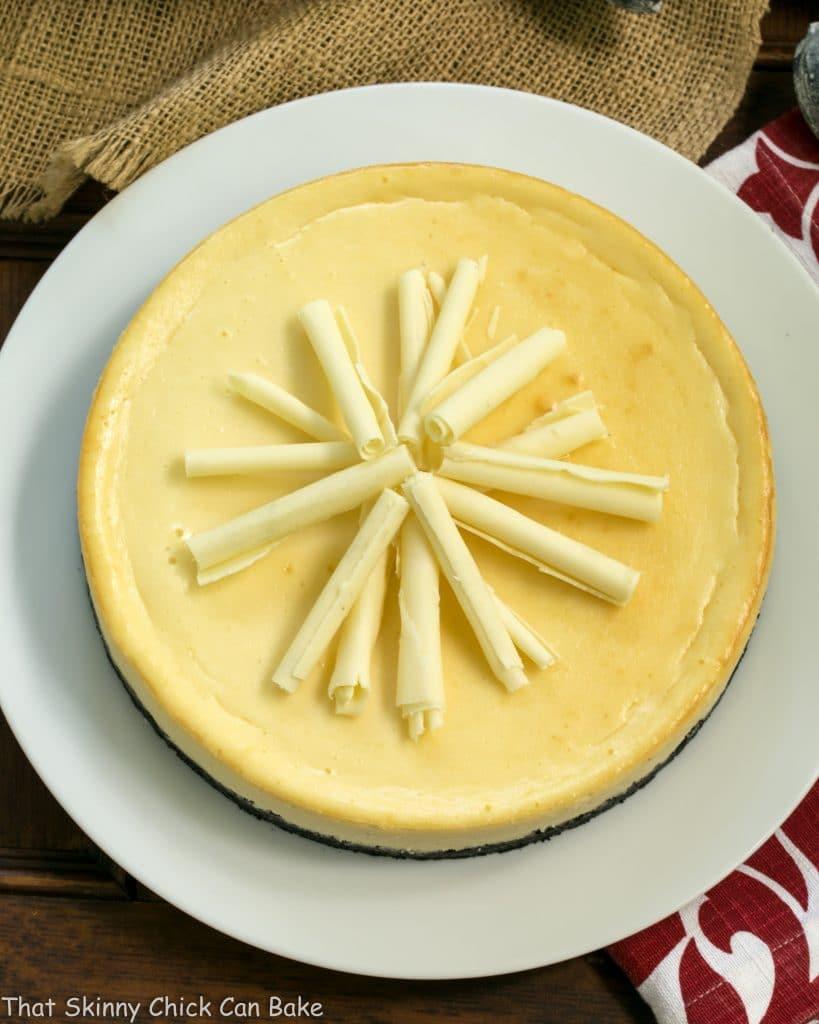 White Chocolate Frangelico Cheesecake on white platter