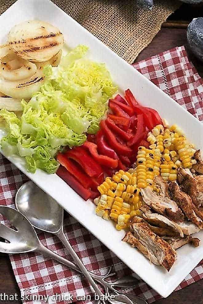 Southwestern Chicken Salad ingredients on a white rectangular platter