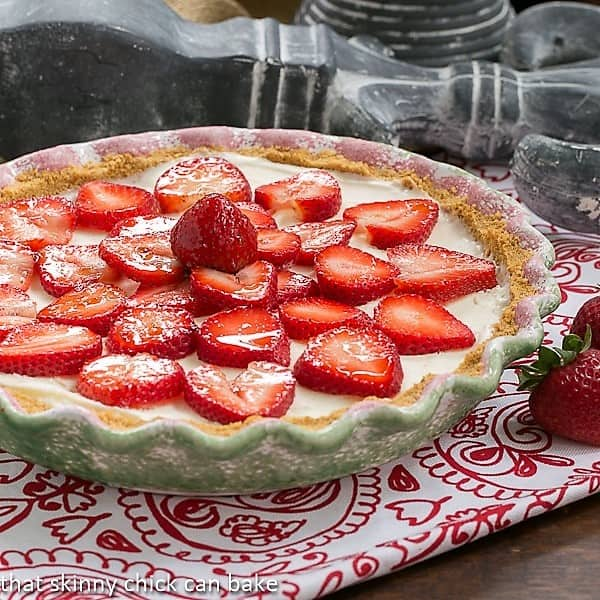 Strawberry Cheesecake Ice Cream Pie in a green and pink pie plate