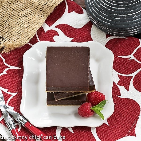 Overhead view of a stack of Truffle Brownies on a white square plate