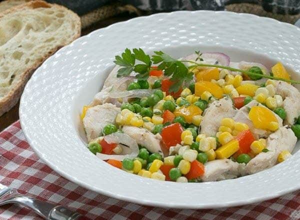 Chicken Peppers and Peas en Papillote   Chicken and vegetables cooked in foil packets