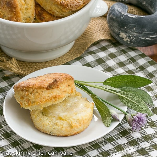 Herbed Buttermilk Biscuits on a white plate with sage and chives