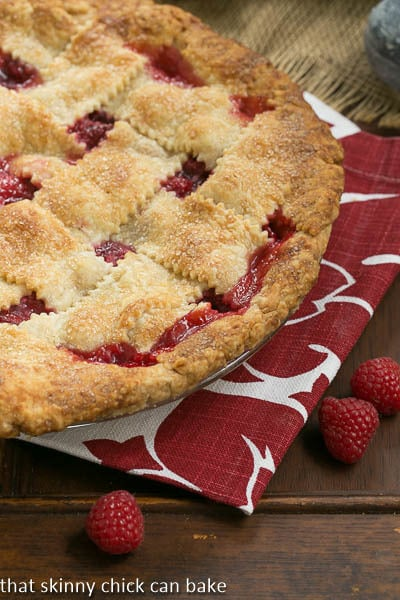 Lattice Topped Raspberry Pie on a red and white napkin
