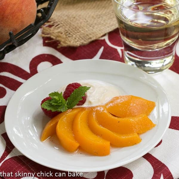 Riesling Poached Peaches with Mascarpone Cream - an elegant, lighter dessert offering!