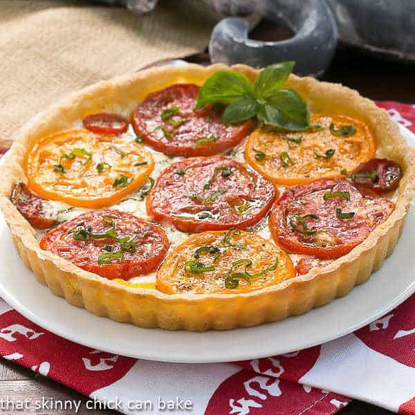Summer Tomato Tart | A pastry shell filled with gooey cheese, fresh tomatoes and basil!