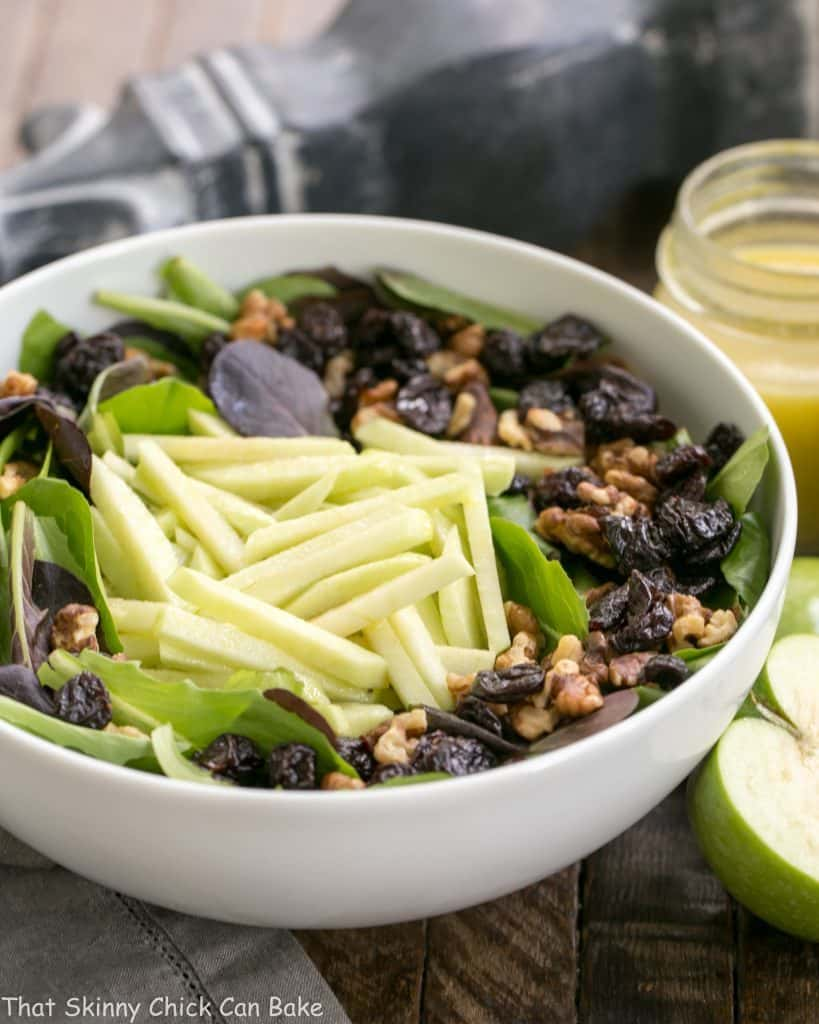 Apple, Cherry, Walnut Salad with Maple Dressing in a white serving bowl
