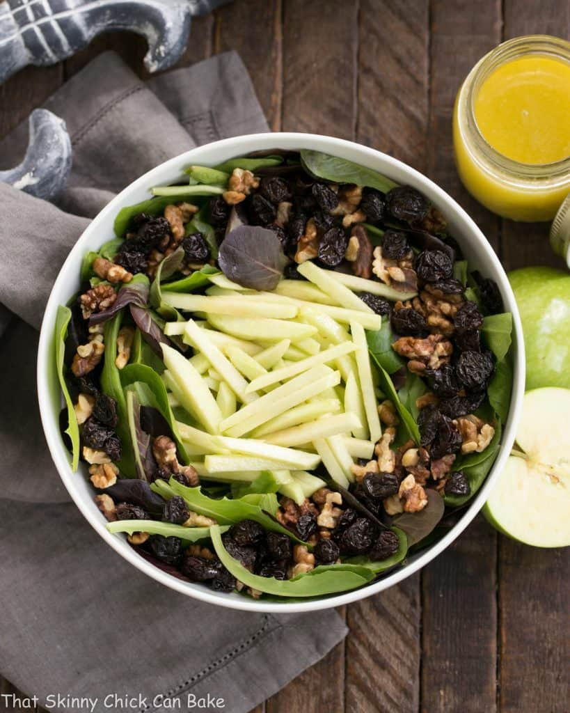 Apple, Cherry, Walnut Salad with Maple Dressing in a white bowl
