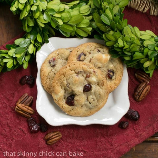 Cranberry, White Chocolate Cookies with Crystallized Ginger on a square white plate