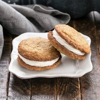 2 Oatmeal Creme PIes on a square white plate