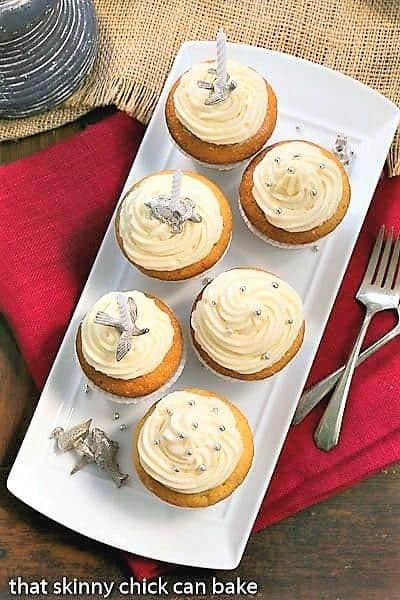 Vanilla Cupcakes with Cream Cheese Frosting on a white rectangular tray