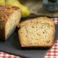 Sour Cream Pear Bread slices on a slate cutting board
