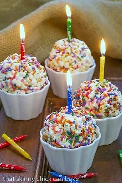 Easy Marshmallow Popcorn Balls with lit birthday candles
