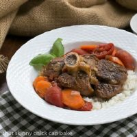 Osso Buco a L'arman over rice in a white bowl