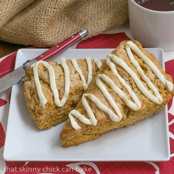Pumpkin Scones  with a white chocolate drizzle on a white plate