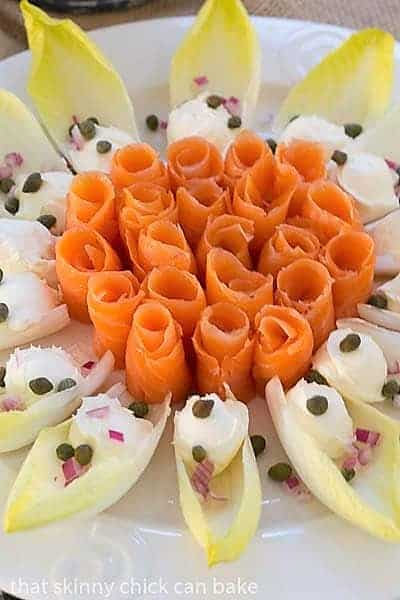 Close view of Smoked Salmon Roses with Endive and Creme Fraiche on a serving plate