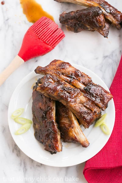 Overhead view of Oven Baked Asian Baby Back Ribs on a small white plate