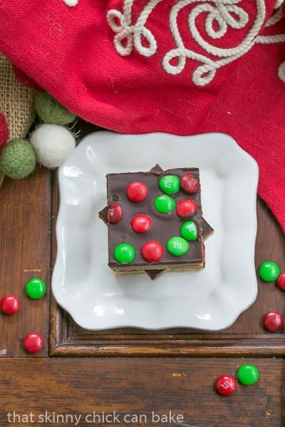 Overhead view of Candy Topped Toffee Squares  on a small white plate