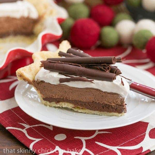 Black Bottom Chocolate Mousse Pie on a white dessert plate with a red handled fork