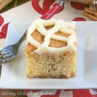 Cinnamon Roll Coffee Cake slice on a white square plate
