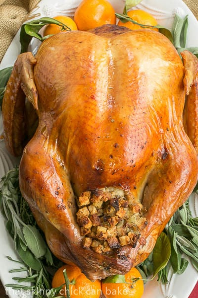 Overhead view of Dry Brined Turkey with sage, rosemary and oranges