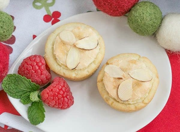 Almond Raspberry Tartlets | Raspberry jam and almond paste fill cream cheese pastry tartlets