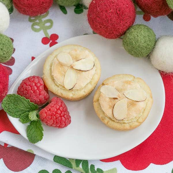 Almond Raspberry Tartlets - Raspberry jam and almond paste fill cream cheese pastry tartlets