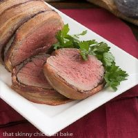 Two slices of beef tenderloin warpped in bacon