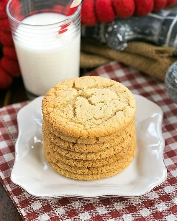 Chewy Butterscotch Cookies on a white plate with a glass of milk