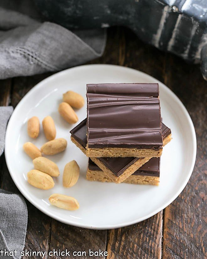 Homemade Reese's Bars on a round white plate viewed from above