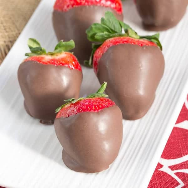 Mascarpone Filled Chocolate Dipped Strawberries on a serving tray