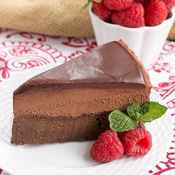 Frozen Chocolate Mousse Cake on a white ceramic plate on a red and white napkin