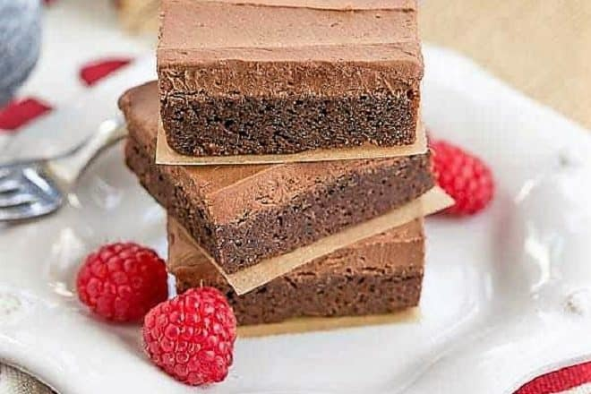 Rich Frosted Brownies on a small, white octagonal plate