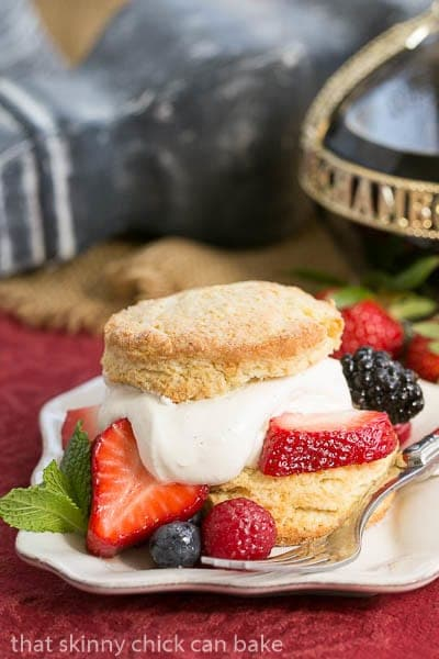 Berry Shortcakes | Sweet tender biscuits topped with berries and cream make for the epitome of spring desserts!
