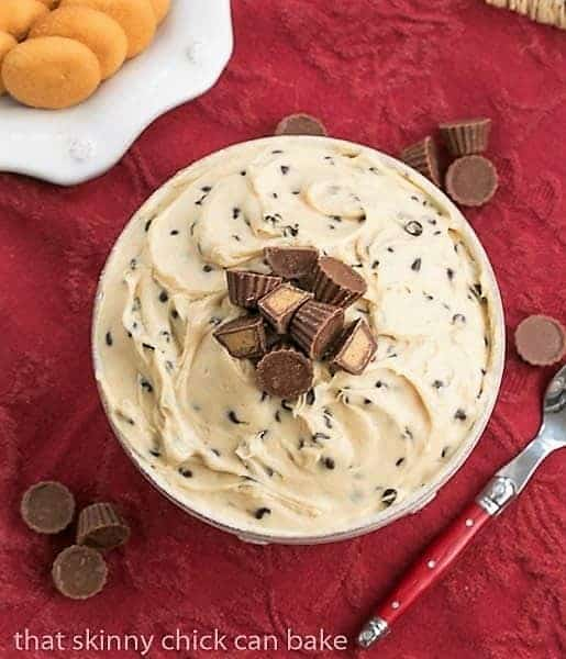 Overhead view of Tagalong dip in a serving bowl topped with mini Reeses peanut butter cups