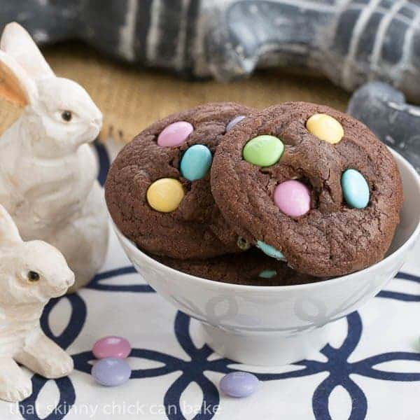 Easter Candy Brownie Cookies in a white bowl with small wooden bunnies