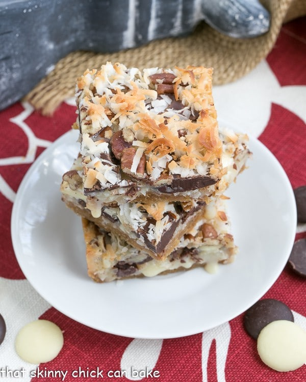The Best Seven Layer Bars stacked on a round white plate