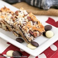 The Best Seven Layer Bars on a rectangular, white tray