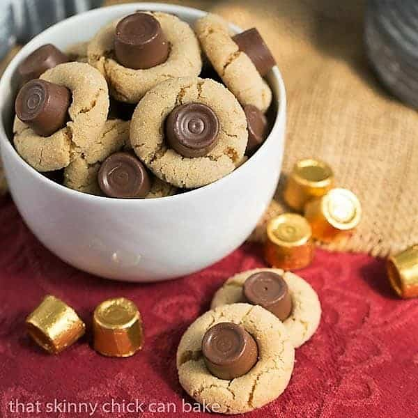 Rolo Peanut Blossoms in a white bowl with two cookies on the side