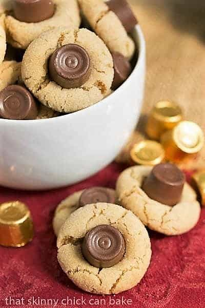 Rolo Peanut Blossoms in a white bowl with a few candies and cookies on the side
