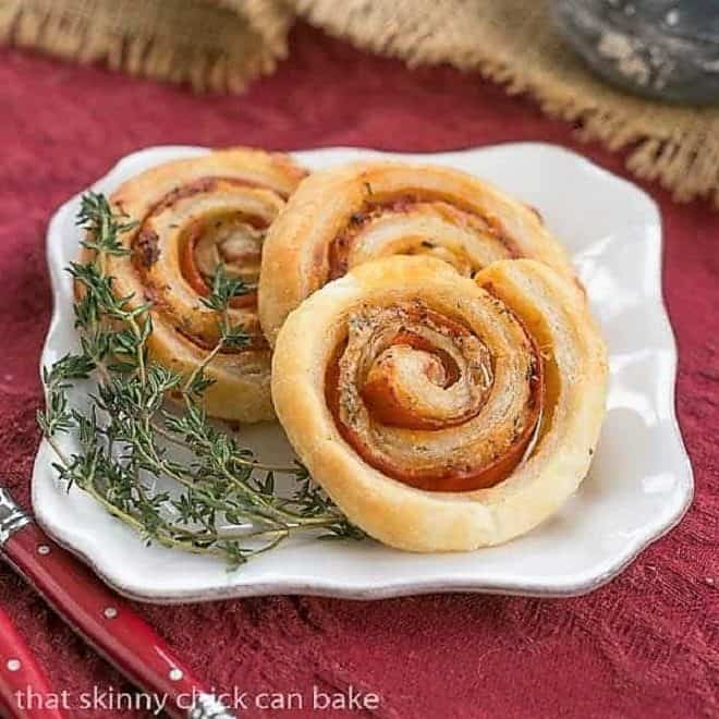 Honey Mustard Pepperoni Pinwheels on a square white plate garnished with thyme