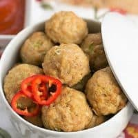 Sesame Ginger Meatballs in a white lidded serving dish